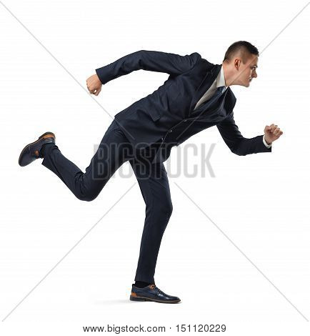 Full growth portrait of a businessman acting like he is running, isolated on a white background. Pursuit of success. Sense of purpose. Moving forward.