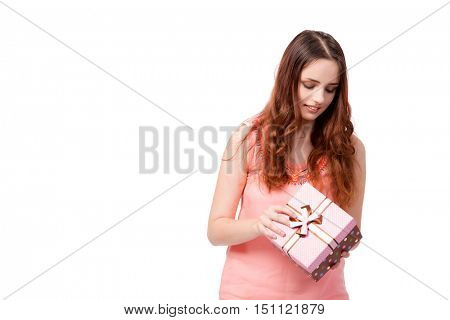 Young woman with giftbox isolated on white