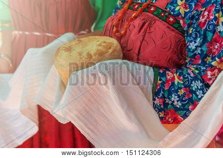 Russian old-fashioned wedding. Hands with bread, meeting with guests