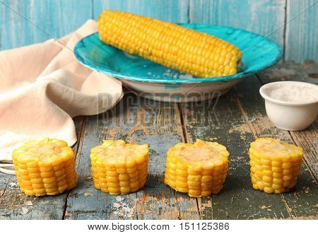 Boiled Corn In Blue Plate And Chopped Corn Ear