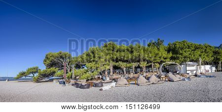 BOL, ISLAND BRAC, CROATIA - JULY 17, 2016: Aurum club at Zlatni rat beach in the morning before guests are arriving at the club