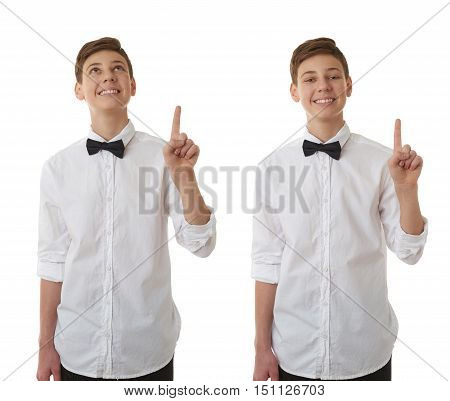 Set of cute teenager boy in white shirt and black bow tie pointing up over white isolated background, half body