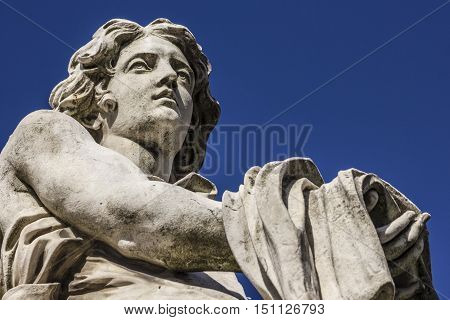 Detail of the Angel with garment and the dice of the sculptor Paolo Naldini on Sant'Angelo bridge in Rome Italy