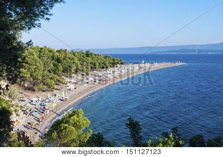 BOL, ISLAND BRAC, CROATIA - AUGUST 15, 2011: Zlatni rat beach crowded with swimmers and surfers in high season
