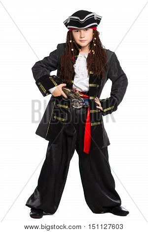 Young boy dressed as pirate posing in the studio. Isolated on white