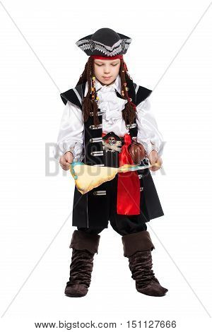 Young boy posing with a map in the suit of pirate. Isolated on white