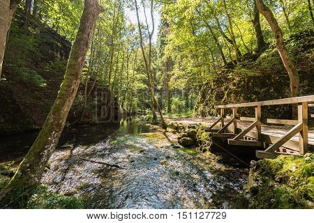 Beautiful landscape with a bridge over river Hasenbach near the Wimsener Cove in the biosphere area of the Swabian Alb