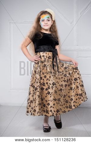 Young Girl Posing In Black And Beige Dress