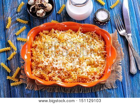 Pasta casserole with cheese, eggs and milk.