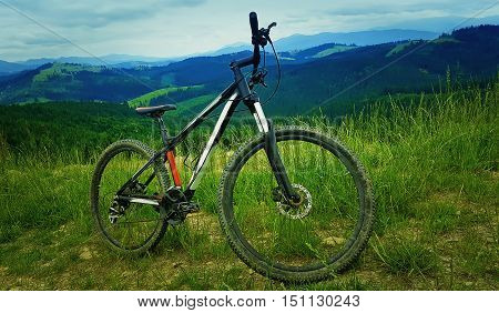 A bicycle over the moutains backround. Biking adventure and traveling symbol. Healthy lifestyle concept