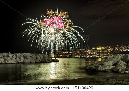 fireworks at sea in the Bay of Naples on the occasion of the feast of Piedigrotta