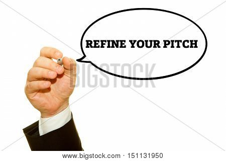 Hand writing REFINE YOUR PITCH with a marker on transparent wipe board.