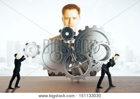 Two businessmen pushing and dragging abstract gear mechanism on light city background with another businessman watching them. Supervision concept. 3D Rendering