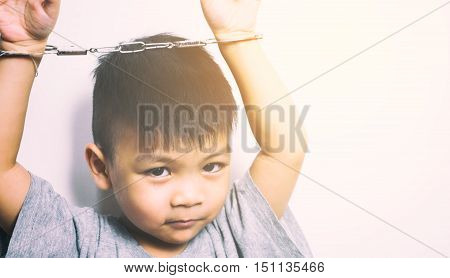 asian naughty boy locked up by handcuff on white background