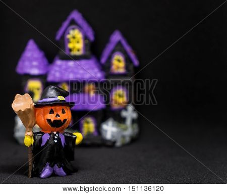 halloween Pumpkins ghost house with black copy space