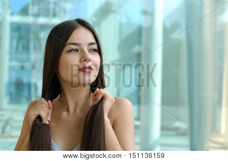 Beautiful Girl Touches Her Hair