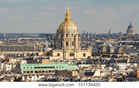 The panorama of parisian houses and cathedral Saint Louis Paris France.