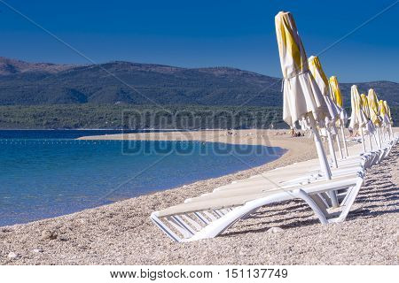 Rows of chairs and parasols on beach; Zlatni rat