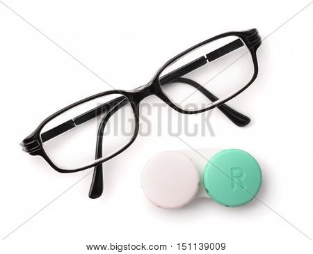 Top view of eyeglasses and eye contact lenses isolated on white