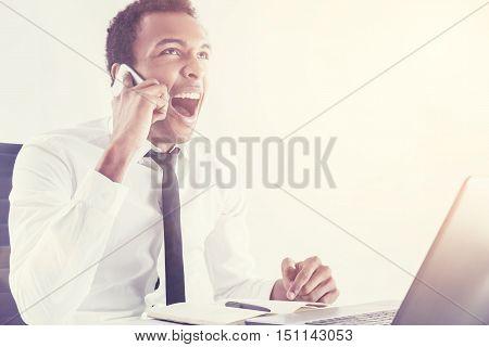 Black Man Shouting On Mobile Phone