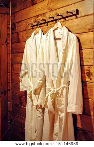 Robes in a luxury wooden cabin hotel suite
