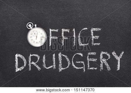 office drudgery phrase handwritten on chalkboard with vintage precise stopwatch used instead of O