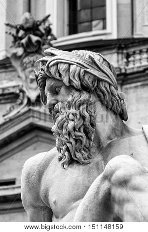 Detail of a statue of the Fountain of the Four Rivers in Piazza Navona Rome