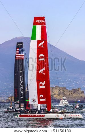 April 20 2013, Naples Italy - The Italian Prada team competes in the American's cup in the Gulf of Naples in the background Castel dell 'Ovo