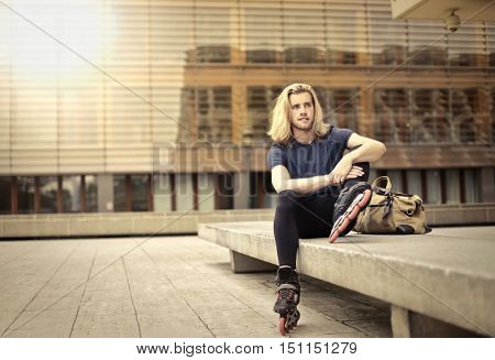 Skater sitting on a bench