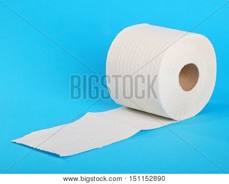 Stack of toilet paper against blue background