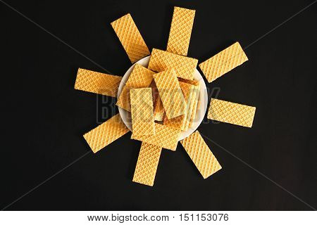 Useful wafers lying in a circle on the black table