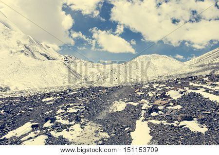 Snow covered high slopes of mountain pass. Thorong La is heighest point of Annapurna trek at 5416m.