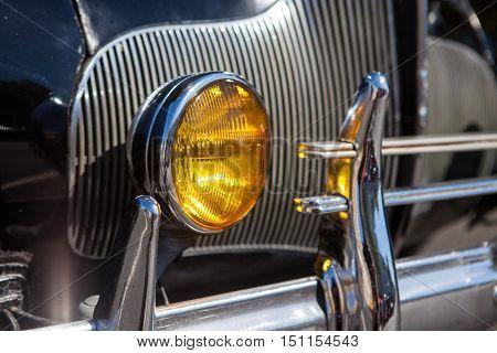 Close-up photo of retro car headlights. Old vintage car