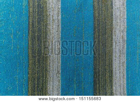 Knitted stripe fabric blue striped background.Knited texture.Manufacture.