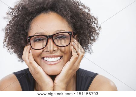 A beautiful intelligent mixed race African American girl or young woman with perfect teeth happy laughing wearing geek glasses