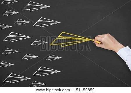 Drawing Airplane Leadership Concept on Chalkboard Background