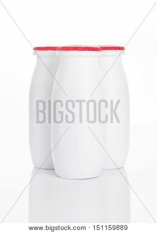Yogurt containers healthy vitamin drink on white background