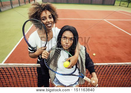young pretty girlfriends hanging on tennis court, fashion stylish dressed swag, best friends happy smiling together, lifestyle people concept close up