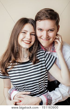 couple of happy smiling teenagers students, warm colors having a kiss, lifestyle people concept, boy and girl together forever inlove