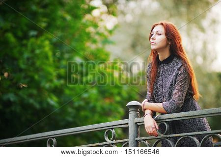 portrait of a beautiful brown-haired girl with big eyes and a calm look.