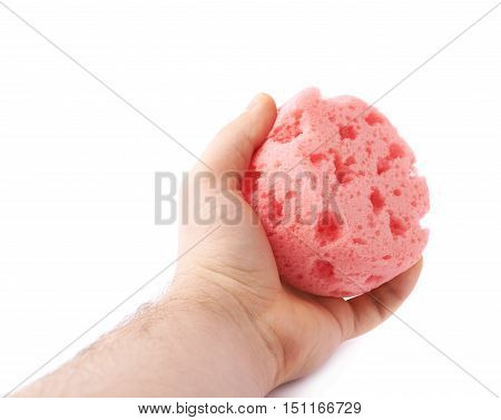 Hand with red pink bathing sponge isolated over the white background