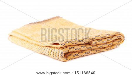 Folded yellow rag towel isolated over the white background