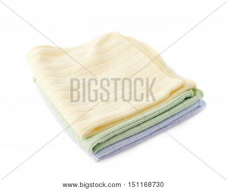 Pile of colorful folded rags over white isolated background