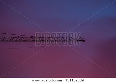 Crane and early morning purple maroon skies