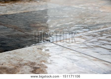 Photograph of a wet stone floor detail