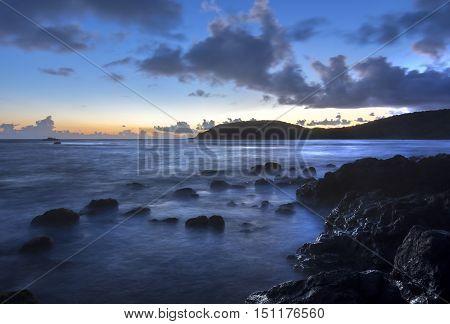 Slow shutter effect before sunset causing mystic motion blur of sea shore on northwest point of Flamenco peninsula on Isla Culebra
