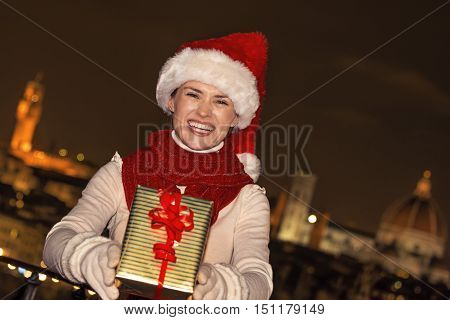 Smiling Woman In Florence, Italy Giving Christmas Present