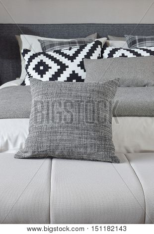 Gray Pillow On Bench With Monotone Bedding