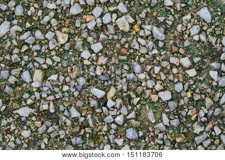 Texture of small stone gravel on the ground