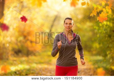 Athlete young woman running in morning sunrise training for marathon and fitness. Healthy active lifestyle in outdoor